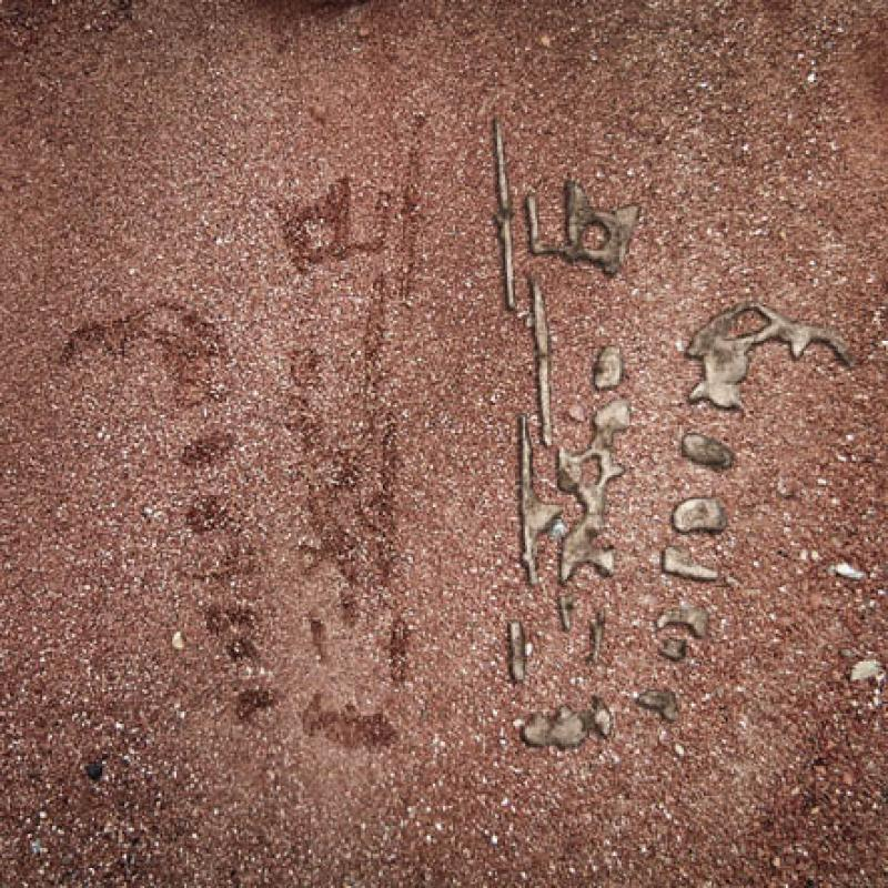 The drawings that Aboriginals sketch in the sand to communicate their oral histories exist for only moments. Here, the crudeness of those momentary drawings is captured with molten metal, where a drawing of a landscape of mining value is captured in new artefacts.