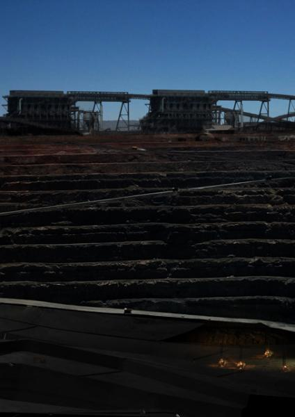The Kalgoorlie Super Pit becomes a fine-tuned machine of artificial creation, as even the most basic excavation processes reminiscent of the old gold-mining days still devour the pit.