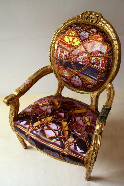 Re-upholstered chair with sexualised ornamental motifs and perspective drawings printed on silk.