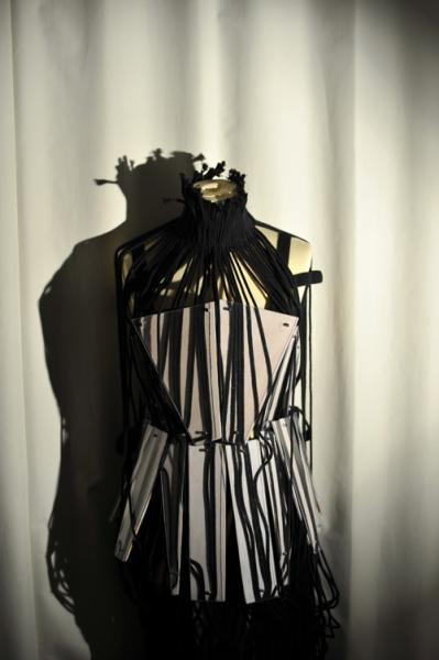 Dress representing restriction through corset and and rope