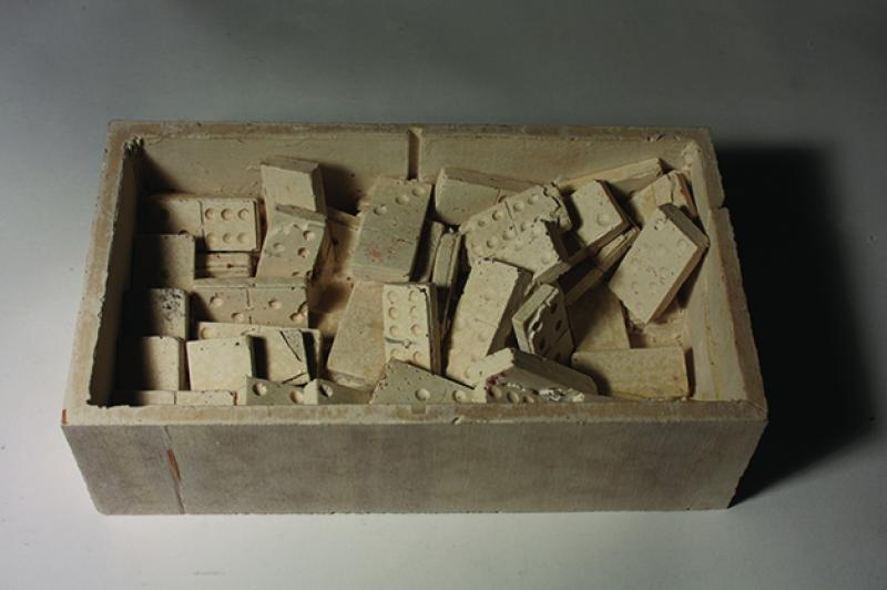 Preservation of the certain moment through casting objects: dominoes and box.