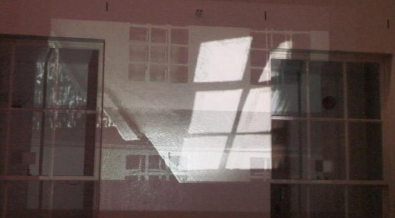 Complicating the limits of the courtyard space outside the Foundation Studio. Projection of my film on the courtyard facade at night time. The film consists of time-lapsed footage of the light/ shadow patterns taken during the day superimposed over a film of the facade wall fracturing open and closing repeatedly. I played with reality and the idea of a confused reality to change one's perception of a space. Dematerialising the confining walls and breaking down the barriers in the mind to try and subvert the claustrophobic space and change one's experience within it.